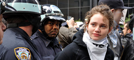 A young woman protester is handcuffed and detained on the Brooklyn Bridge by the NYPD. 10/01/11. (photo: Stanley Rogouski/flickr)