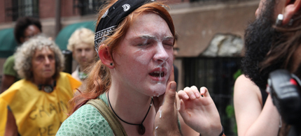 Kelly Schomburg, 18, receiving medical treatment after being pepper-sprayed by police, and mere moments before being arrested, 09/24/11. (photo: Jim Kiernan)