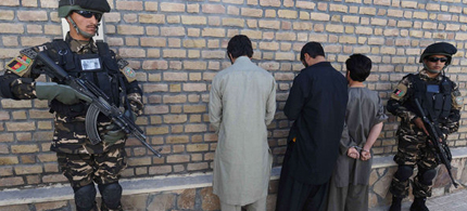 Afghan security officers guard arrested Taliban fighters in Herat. (photo: Aref Karimi/Getty Images)