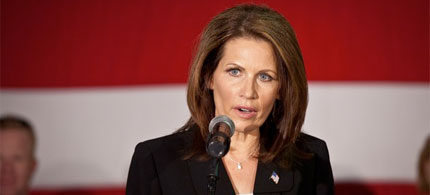 Michele Bachmann appears stunned as Occupy Charleston protesters using the human microphone technique interrupt her speech aboard the USS Yorktown in South Carolina, 11/11/11. (photo: Getty Images)