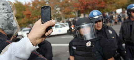 A citizen-journalist films Denver police at Occupy Denver, 10/29/11. (photo: John Moore/Getty Images)