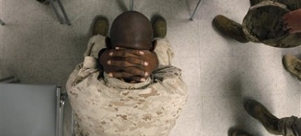 An anxious Marine waits to take psychological tests at the Marine Corps Air Ground Combat Center in Twentynine Palms, CA, 09/29/09. (photo: Jae C. Hong/AP)