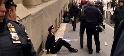 Retired Philadelphia Police Captain Ray Lewis, handcuffed, forced to sit on the ground, and arrested by New York City police, 11/17/11. (photo: Death and Taxes)