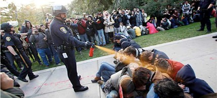 UC Davis Police Lt. John Pike uses pepper spray to move Occupy UC Davis protesters blocking a walkway in the quad on Friday, 11/18/11. (photo: Wayne Tilcock/Davis Enterprise)