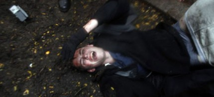 OWS protester Brandon Watts lies injured on the ground after clashes with police during the eviction of Zuccotti Park. (photo: Allison Joyce/Getty Images)