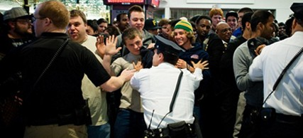 Black Friday shoppers attempt to push through security staff moments after the doors opened at the Mall of America in Bloomington, Minnesota, 11/25/11. (photo: AP)