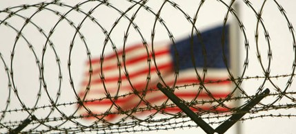 A razor-wire fence at Guantanamo, where 'enemy combatants' are being held indefinitely. (photo: Brennan Linsley/Reuters)