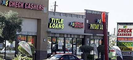 A growing number of credit unions around the country are offering payday loans and competing with traditional payday loan businesses, like those shown here in Phoenix, 05/27/11. (photo: Ross D. Franklin/AP)