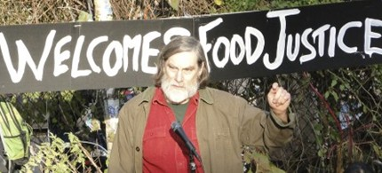 Jim Gerritsen addresses the 'Farmers' March' to Zuccotti Park organized by the Food Justice Committee of Occupy Wall Street, 12/04/11. (photo: Jim Gerritsen/Bangor Daily News)