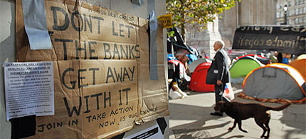 Protest posters on the walls surrounding the Occupy London camp. (photo: Dan Kitwood/Getty Images)