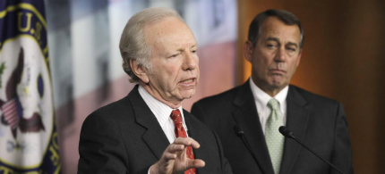 Sen. Joseph Lieberman (I-Conn.), left, accompanied by House Speaker John Boehner of Ohio, gestures during a news conference on Capitol Hill in Washington, 01/26/11. (photo: Charles Dharapak/AP)