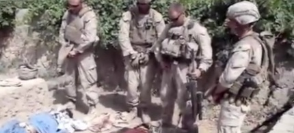 A video anonymously posted on the web allegedly shows American forces in Afghanistan urinating on the bodies of dead Taliban fighters. (photo: Reuters)