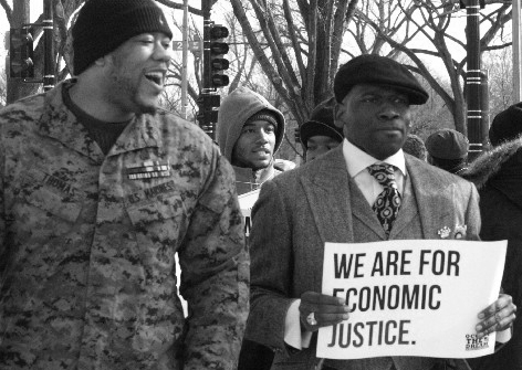 Sgt. Shamar Thomas and Reverend Jamal Bryant lead a picket line in front of the Federal Reserve in Washington DC, as part of an Occupy the Dream rally, 01/16/12. (photo: Scott Galindez/RSN)