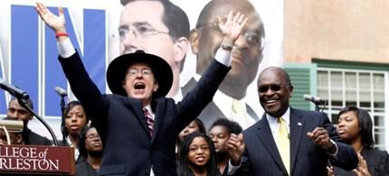 Stephen Colbert rallies with Herman Cain in South Carolina, 01/19/12. (photo: Jason Reed/Reuters)