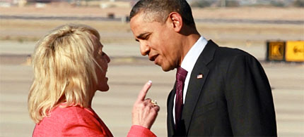 President Obama did not take so kindly to Arizona governor Jan Brewer's greeting at a Phoenix airport. (photo: Haraz N. Ghanbari/AP)