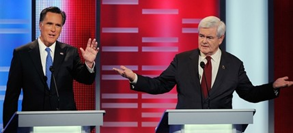 The GOP's 'Odd Couple' shares a moment during one of the many GOP debates, 01/10/12. (photo: AP)
