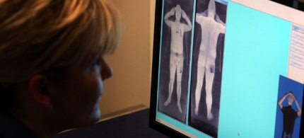 TSA's body scanners allow security personnel to view people naked 'for security reasons.' (photo: Gallo/Getty Images)