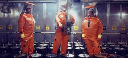 Rocky Flats nuclear facility workers in a plutonium storage area, 1988. (photo: US Dept of Energy)