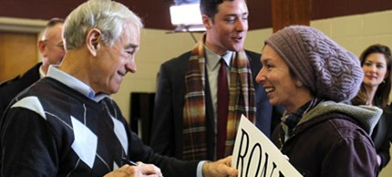 Ron Paul greets one of the young supporters who have helped him collect the second-most delegates this far. (photo: Robert F. Bukaty/AP)