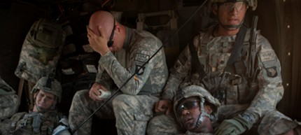 Wounded and tired US soldiers being evacuated from a battle in Afghanistan. (photo: Adam Dean Photography)