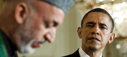 Presidents Hamid Karzai and Barack Obama at the White House. (photo: Jim Watson/AFP/Getty Images)