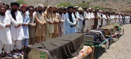 Villagers offer funeral prayers for people reportedly killed by a US drone attack in Miranshah, capital of the Pakistani tribal region of North Waziristan, June 16, 2011. (photo: Hasbunullah/AP)