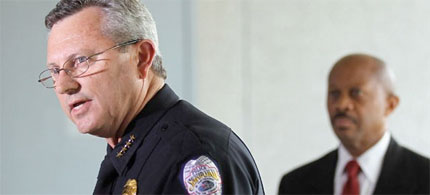 Sanford Police Department Chief Bill Lee (L) speaks while announcing he will temporarily step down in the wake of the Trayvon Martin killing in Sanford, Florida. (photo: Mario Tama/Getty Images)