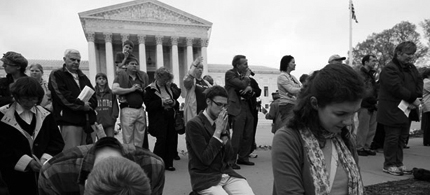 Opponents of healthcare reform pray in front of the Supreme Court. (photo: Doug Mills/NYT)