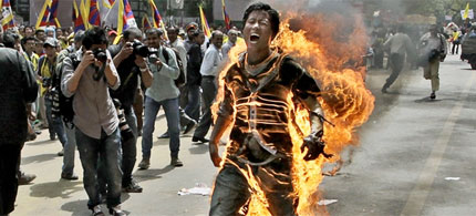 Tibetan exile Jamphel Yeshi set himself on fire during a protest against the visit of Chinese President Hu Jintao to India. (photo: Manish Swarup)