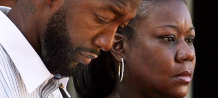 Trayvon Martin's parents mourn the death of their son. (photo: Reuters)