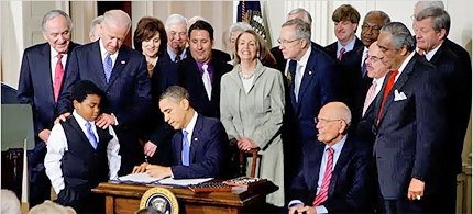 President Barack Obama signs into law the Patient Protection and Affordable Care Act (aka ObamaCare) on March 23,2010. (photo: Doug Mills/NYT)