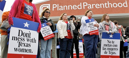 Local citizens and employees of the Planned Parenthood clinic in San Angelo, Texas gather in front of the clinic Thursday, March, 8, 2012 to participate in the 'Don't Mess with Texas Women' rally. (photo: Patrick Dove/AP)
