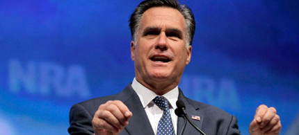 Romney received a standing ovation from the crowd at the NRA convention. (photo: AP)