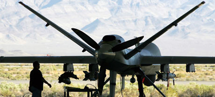 An MQ-9 Reaper 'hunter-killer' drone at a USAF base in Nevada. These craft can carry laser-guided bombs and air-to-ground missiles. (photo: Ethan Miller/Getty Images)