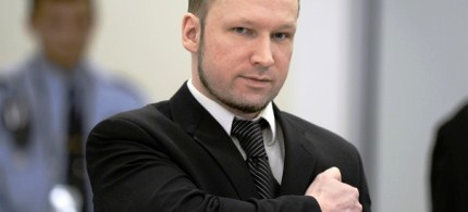 Self-confessed mass murderer and right-wing extremist Anders Behring Breivik places a clenched fist on his heart in a salute on day three at the central court in Oslo, 04/18/12. (photo: Odd Andersen/AFP/Getty Images)