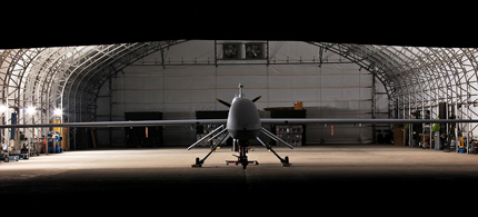 An MQ-1C Sky Warrior unmanned aircraft, which has the ability to remain airborne for up to 24 hours straight sits dormant in a hanger. (photo: Sgt. Travis Zielinski/US Army)