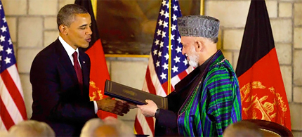 President Obama and President Hamid Karzai of Afghanistan signed an agreement in Kabul on Tuesday, 05/01/12. (photo: Doug Mills/NYT)