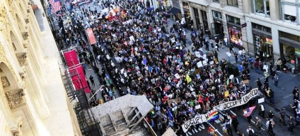 Occupy Wall Street participants stage a march down Broadway as part of May Day celebrations in New York, 05/01/12. (photo: Getty Images)
