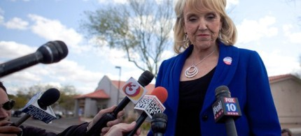 Arizona Gov. Jan Brewer talks to the news media after voting in the Republican presidential primary, 02/28/12. (photo: Jonathan Gibby/Getty Images)