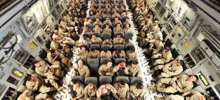 US servicemen inside a plane before their departure to Afghanistan, 03/27/12. (photo: Vyacheslav Oseledko/AFP/Getty Images)