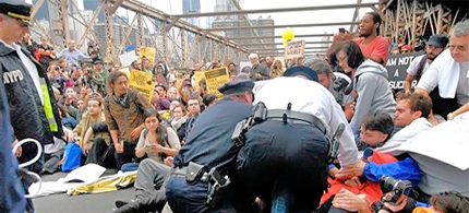 Malcolm Harris was among some 700 protesters who were arrested in October during a march across the Brooklyn Bridge. (photo: Stephanie Keith/AP)