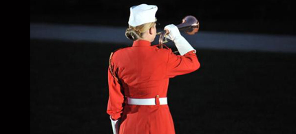 U.S. Marine Corps Sgt. Cody Mamalis, left, a bugler from the The Commandants Own, the United States Marine Drum and Bugle Corps, sounds assembly to Marine Barracks Washington in Washington, D.C., July 1, 2010. (photo: Sgt. Alvin Williams)