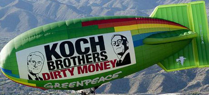 Not just a blimp on the horizon: A Greenpeace ad attacking rightwing industrialists and Super-PAC funders David and Charles Koch. (photo: Gus Ruelas/Greenpeace)