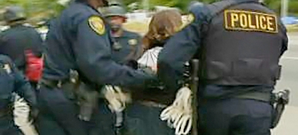A woman is arrested at the scene of a police raid on Gill Tract in Albany, May 14, 2012. (photo: CBS)