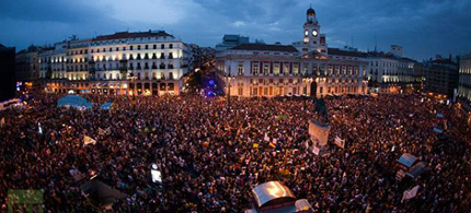 Spanish protesters fill up the Puerta del Sol square during a protest marking the one year anniversary of Spain's Indignados movement. (photo: Paul Hanna)
