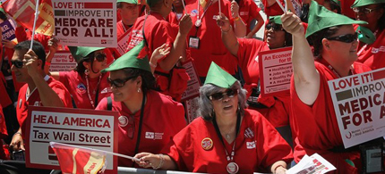 Members of National Nurses United gather in Daley Plaza calling for a 'Robin Hood' tax on stocks, bonds, derivatives and other financial instruments May 18, 2012 in Chicago, Illinois. (photo: Getty Images)