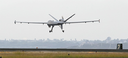 A Predator B unmanned aircraft lands after a mission at the Naval Air Station, Tuesday, Nov. 8, 2011, in Corpus Christi, Texas. (photo: Eric Gay/AP)