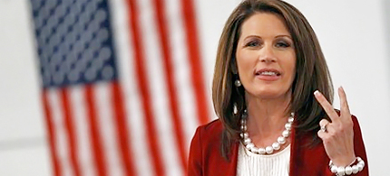Congresswoman Michele Bachmann gestures as she speaks to attendees at the Dallas GOP dinner in Adel, Iowa. (photo: Reuters)