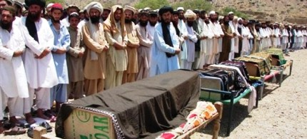 Pakistani villagers offer funeral prayers for people who were reportedly killed by a US drone attack, 06/16/11. (photo: AP)