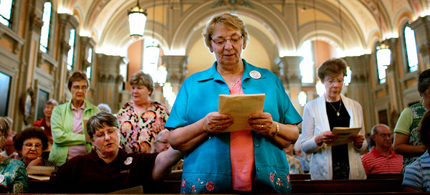 Sister Claudia Bronsing takes part in a vigil at St. Colman Church in Cleveland, Ohio, in support of Catholic nuns who were criticized by the Vatican. (photo: Michael McElroy/NYT)